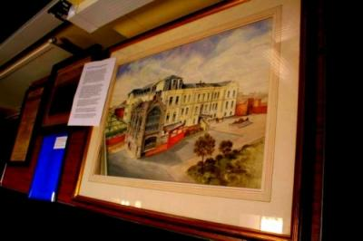 A painting of the RSH Hospital Chapel with the original Victorian built wards in the background on display at the 2013 AGM of Friends of RSH Hospital Chapel [image Ann MacGillivray]