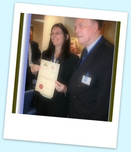Lynn Tapp of the NHS estates being awarded a Certificate of Appreciation by John Avery, Company Secretary of Friends of RSH Hospital Chapel