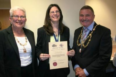 Lynn Tapp, NHS Estates receiving her certificate from the Mayor and Mayoress Councillor and Mrs Burke [image Ann MacGillivray]