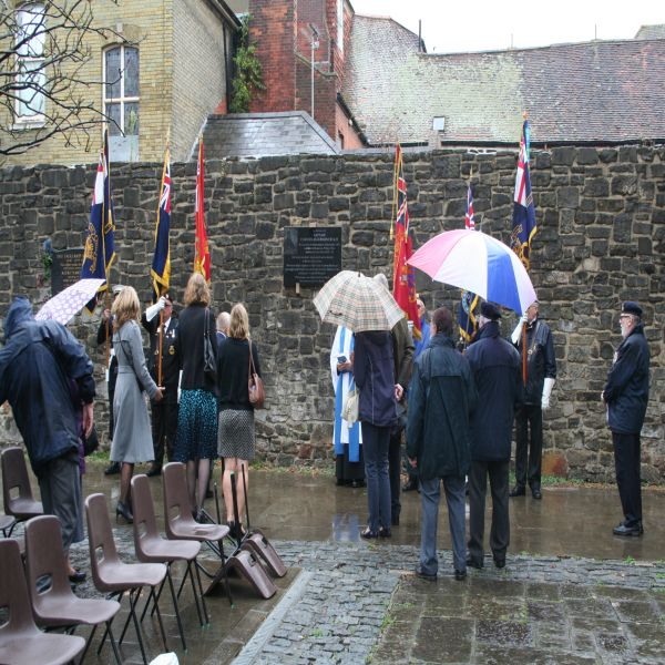On a rainy day the Fryatt family gather for the dedication of the Southampton Fryatt Plaque image Ann MacGillivray