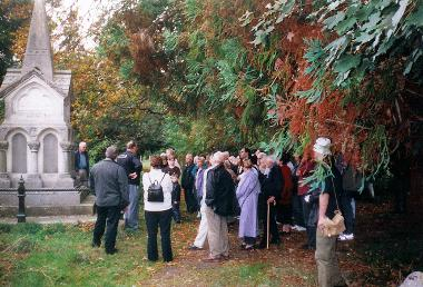 Visitors exploring the Rhone and Wye Memorial at Southampton Old Cemetery